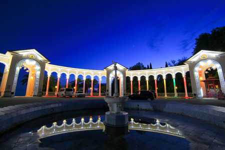 headlights: Colonnade night view with headlights traces Abkhazia Gagra Stock Photo