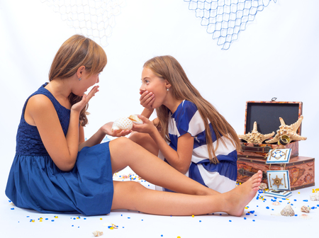 beautiful teen: Two beautiful teen girls sittin on the floor laughing