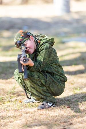 lazer: Boy with a gun playing lazer tag open air Stock Photo