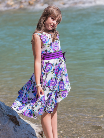 youngsters: Cute preteen long hair girl posing on riverbank