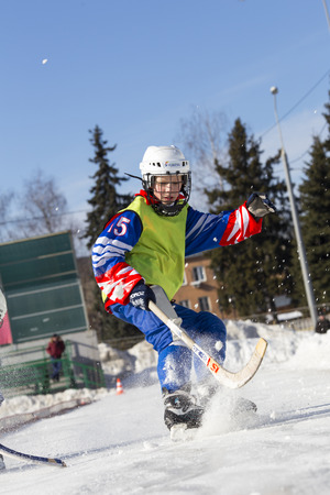 bandy: RUSSIA, OBUKHOVO - JANUARY 10, 2015: 2-nd stage childrens hockey League bandy, Russia. Players warmig-up  before the game