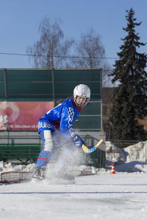 bandy: RUSSIA, OBUKHOVO - JANUARY 10, 2015: 2-nd stage childrens hockey League bandy, Russia. Players warmig-up  before the game.