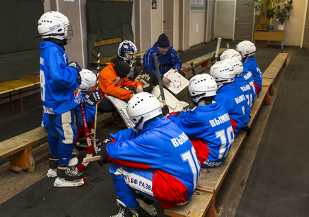 bandy: RUSSIA, KOROLEV - JANUARY 15, 2015: 3-d stage childrens hockey League bandy, Russia. Team listening to the coach before going on the ice