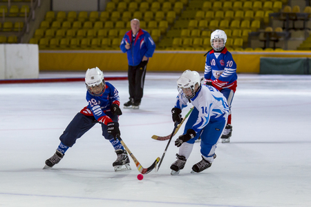 bandy: RUSSIA, MOSCOW - APRIL 20, 2015: training match Vympel-Dynamo, childrens hockey League bandy, Russia