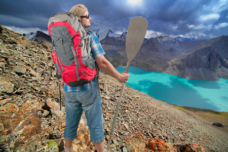 jokul: Tourist man with backpack and paddle on scenery mountain landscape background