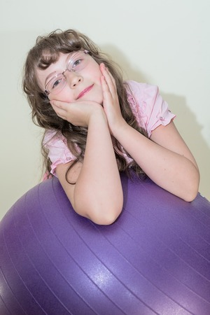 big ball: Young little girl sitting on the big ball