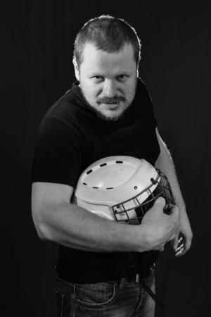 agression: Portrait of a brutal man with sports helmet low key