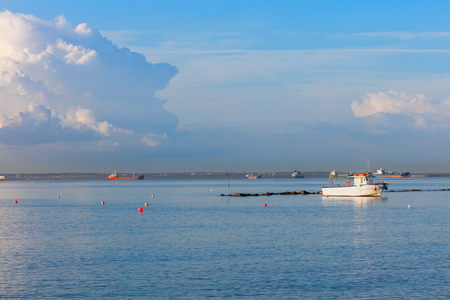limassol: Mediterranean coast in Limassol with vessels and blue sky Cyprus Stock Photo
