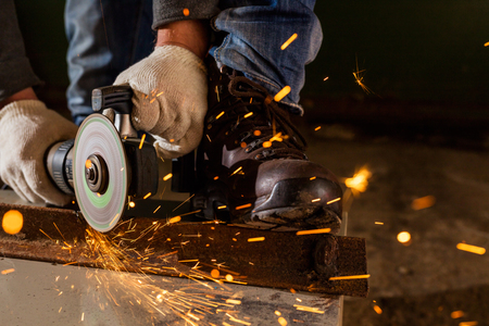 machine tool: Worker working of a grinding machine with a lot of sparks Stock Photo