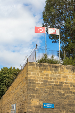 un: NICOSIA, CYPRUS - NOVEMBER 28, 2015: Flags of Northern Cyprus and UN Green Line  in Buffer Zone in Cyprus Editorial