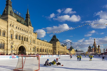 bandy: MOSCOW, RUSSIA - FEBRUARY 27, 2016: Winter view on Red Square with GUM and skate rink
