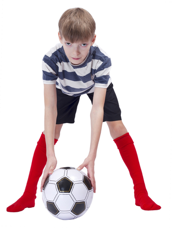 Young football player at striped t-shirt on white background