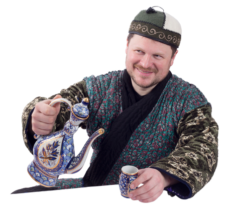 canny: Man in traditional oriental robe with ornamental bowl on white background