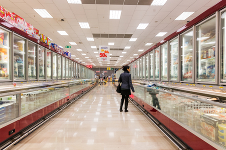 ITALY, MILAN- MAY 11, 2016: Consumers in Lidl store. Lidl is a global discount supermarket chain Editorial