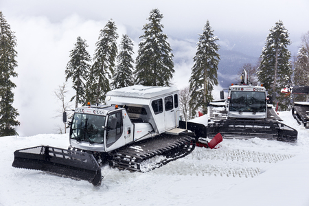 snow grooming machine: RUSSIA, SOCHI, GORKY GOROD - MARCH 26, 2017: Snowcat machines on slopes of Gorky Gorod ski resort are ready for night work