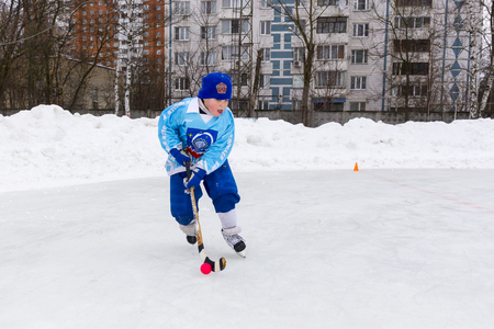 bandy: RUSSIA, KOROLEV- FEBRUARY 18, 2017: Young hockey player have a warm up training before the match on bandy tournament in Korolev, Russia Editorial