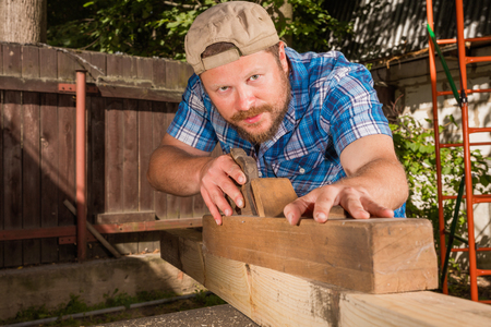 chipping: Carpenter chipping the wooden plank