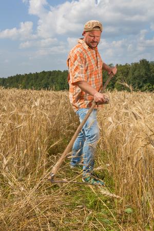 Modern farmer with scythe
