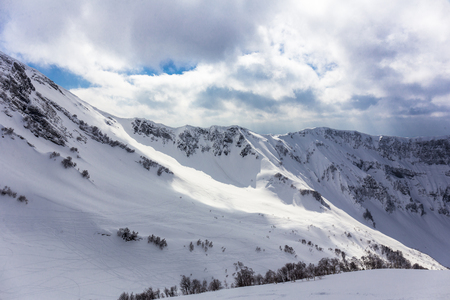 Scenery top view on winter mountains from ski resor Stock Photo