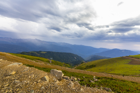 mountainscape: Beautiful mountainscape with cloudy sky and cableway Stock Photo