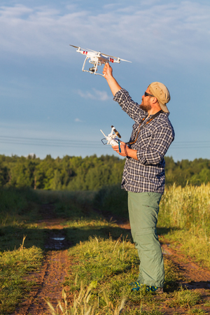 drones: Operator holding drone and controller in his arms Stock Photo