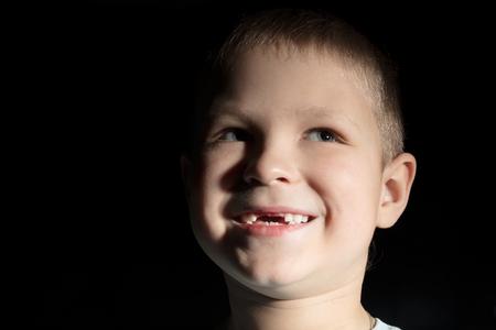 no teeth smile: Cute boy missing some front teeth