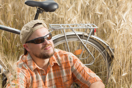 res: Matured traveller in cap and sunglasses having a res Stock Photo