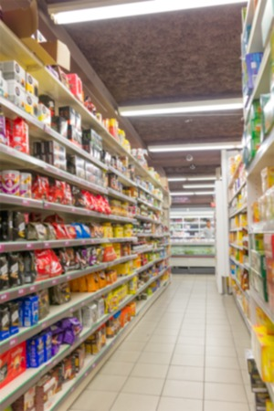 Blurred abstract background of shelf in supermarket interior Stock Photo