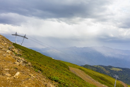 Beautiful mountainscape with cloudy sky and cableway Stock Photo