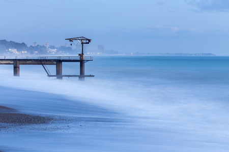 Beautiful seascape with tide and lonely pier
