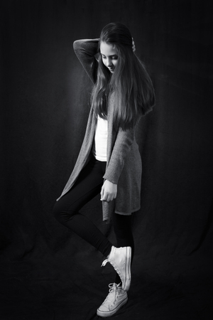 Monochrome portrait of young beautiful girl  standing 스톡 콘텐츠