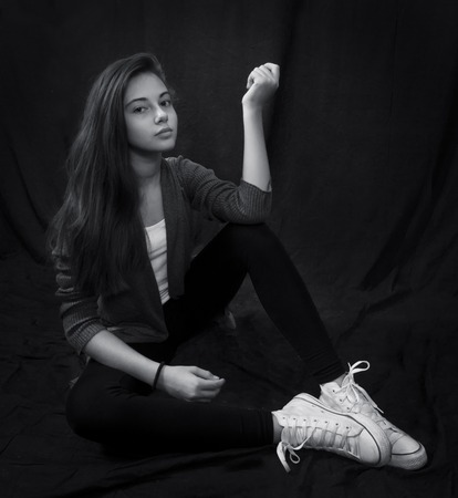 Monochrome portrait of young beautiful girl  sitting