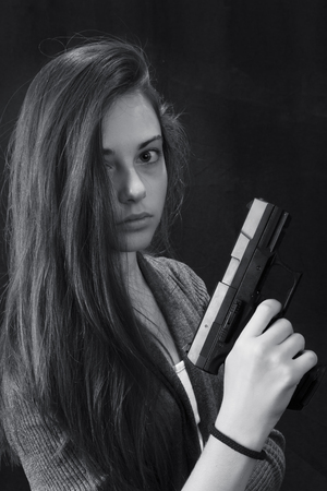 Monochrome close up emotional portrait of young beautiful girl