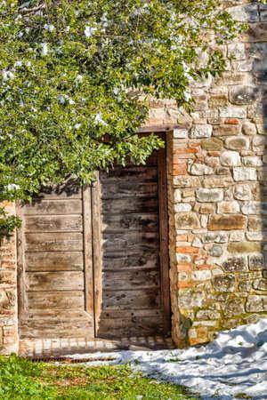 Vintage wooden door and wall view in winter