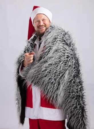 Cheerful Santa dressed in fur skin studio portrait Stock Photo