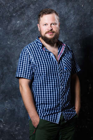 Solid bearded man at casual clothes studio portrait.