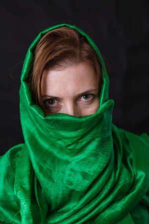 Beautifu musliml woman dressed in green headscarf Archivio Fotografico