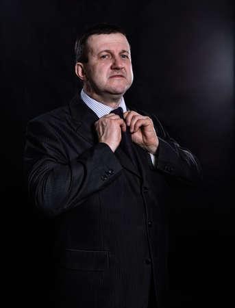Middle aged solid man dressed in suit studio portrait Zdjęcie Seryjne