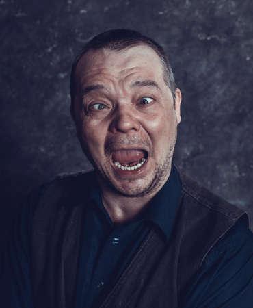 Middle aged social marginal emotional studio portrait.