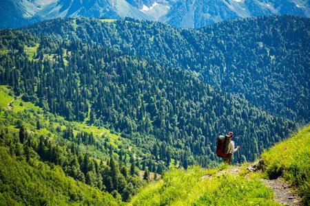 Beautiful mountain landscape with tourists hiking at Caucasus mountains. Standard-Bild