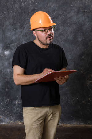 Middle-aged man in a helmet construction superintendent Foto de archivo