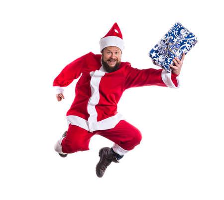Joyful Santa Claus ning to deliver the gifts studio portrait