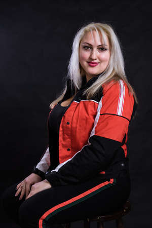 Attractive plump woman dressed in sport style casual