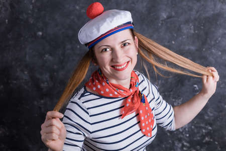 Beautiful midle aged lady having fun in sailors suit Stock Photo