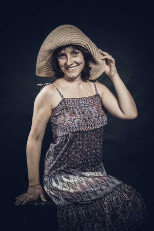 Cheerful 40 years old woman in the purple dress Stockfoto