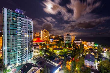 Scenic night cityscape with modern building, Sochi, Russia.