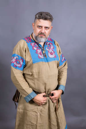Mature bearded man in traditional historic medieval clothes 免版税图像