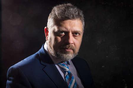 Mature businessman in a suit studio portrait.
