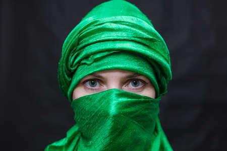 Beautifu musliml woman dressed in green headscarf