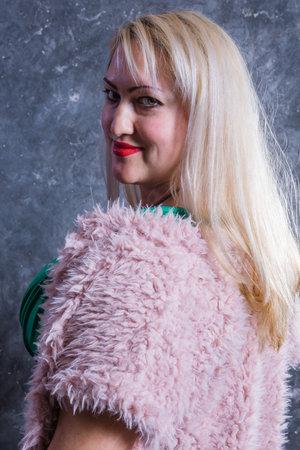 Attractive plump woman studio portrait close up view.